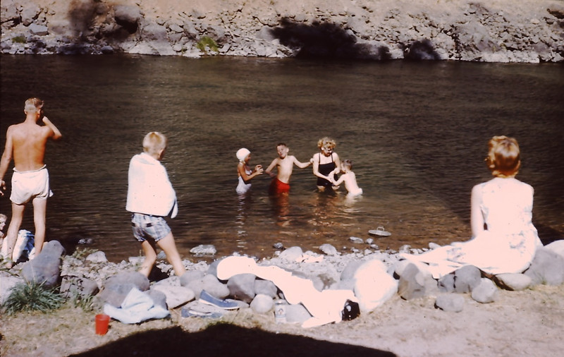 1960 (August) - Dave Yaden, Jr. (age 12) in red swim trucks; other people unidentified - Naches River Cabin - Cliffdell, WA - From the Byron W. Yaden 35MM Slide Collection