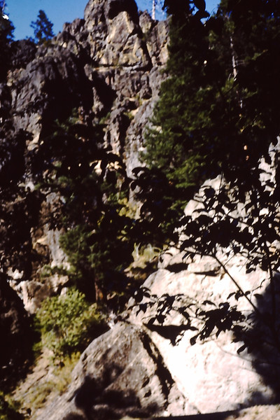 "1962 (June) - The ""Face"" (top center rock) on the cliffs across the river from the Naches River cabin - Cliffdell, WA - From the Byron W. Yaden 35MM Slide Collection"