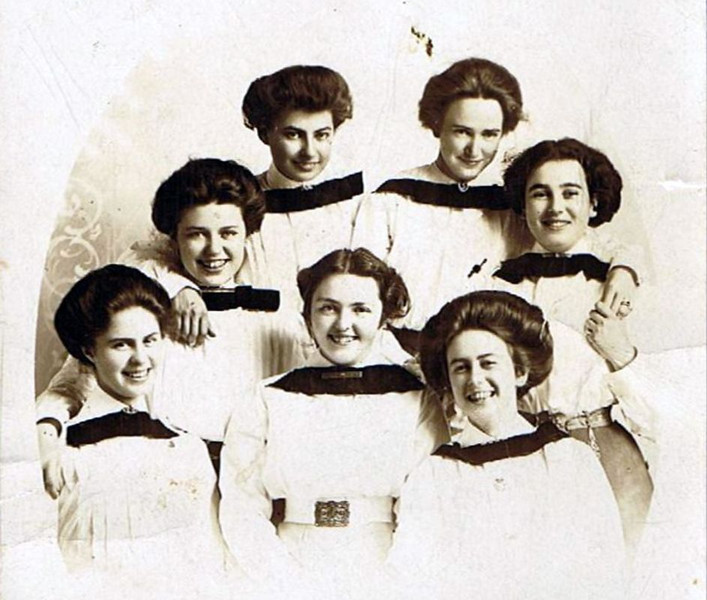 Edna Maxwell [top right] - 1913 - Age 19 (1894-1955) - With her sisters in Durand, WI<br /> <br /> Edna was one of seven Maxwell sisters.  Unfortunately, there is very little documentation on them and no information to match names with faces.  Five of the other sisters were named Sara, Lavia, Vern, Ethel, and Margaret.  At the time of their father's death in 1918 (William J. Maxwell),  Lavia, Vern, and Ethel were already deceased.  The causes of death are unkown. <br /> <br /> Edna Maxwell would marry Byron (Bud) Yaden in Shoshone, ID on May 21, 1920 and give birth to fraternal twins---David Byron Yaden at 11:45 P.M. on February 10, 1921, and William Maxwell Yaden a few minutes after midnight on February 11, 1921.  Both babies were premature, weighing only 3.75 lbs each.  David was kept warm in a padded shoe box on top of a hospital heat register and survived.  Attempts to save William were unsuccessful and he died 12 hours after birth.
