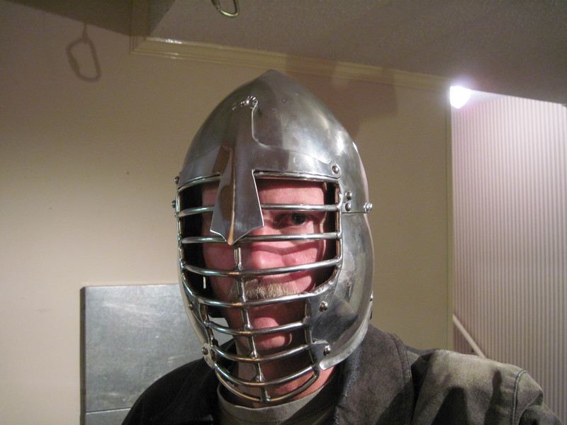 Bud Lewis trying on his SCA helmet for heavy fighting.