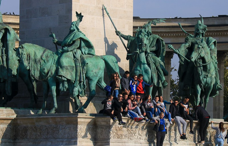 A tour group invades Heroes Square.
