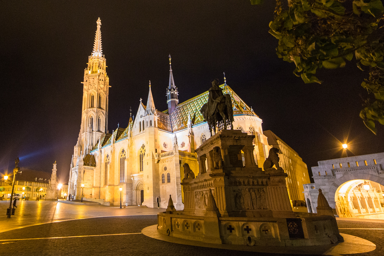St Mathias church and statue of St Stephens at night
