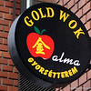 Gold wok restaurant sign in Budapest, Hungary in January 2014