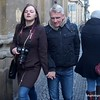 Couple walking in Prague, Czech Republic in February 2014. She is younger, he is older and she has a Canon DSLR camera