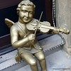 A statue of a golden angel playing the violin in Prague, Czech Republic in February 2014