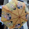 A beautiful painted umbrella with images of Asian women outside  a shop in Prague, Czech Republic in February 2014
