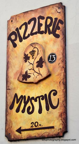 Mystic pizza sign in Prague, Czech Republic in February 2014