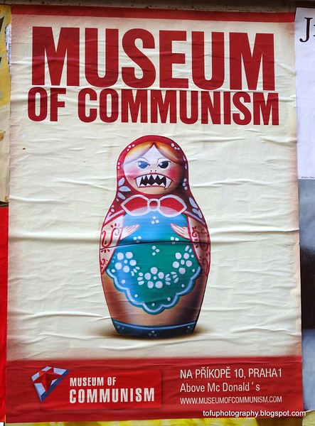 Poster for the museum of communism in Prague, Czech Republic in February 2014. A babushka doll with bite!