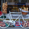 A bicycle with bread sticks outside a cafe in Narodni Street in Prague, Czech Republic, in February 2014