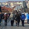 People walking on the Charles Bridge over the Vltava River in Prague, Czech Republic in February 2014