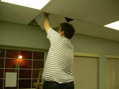 Last ceiling tile goes in
