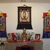 Our simple shrine displays representations of Buddha's body, speech, and mind