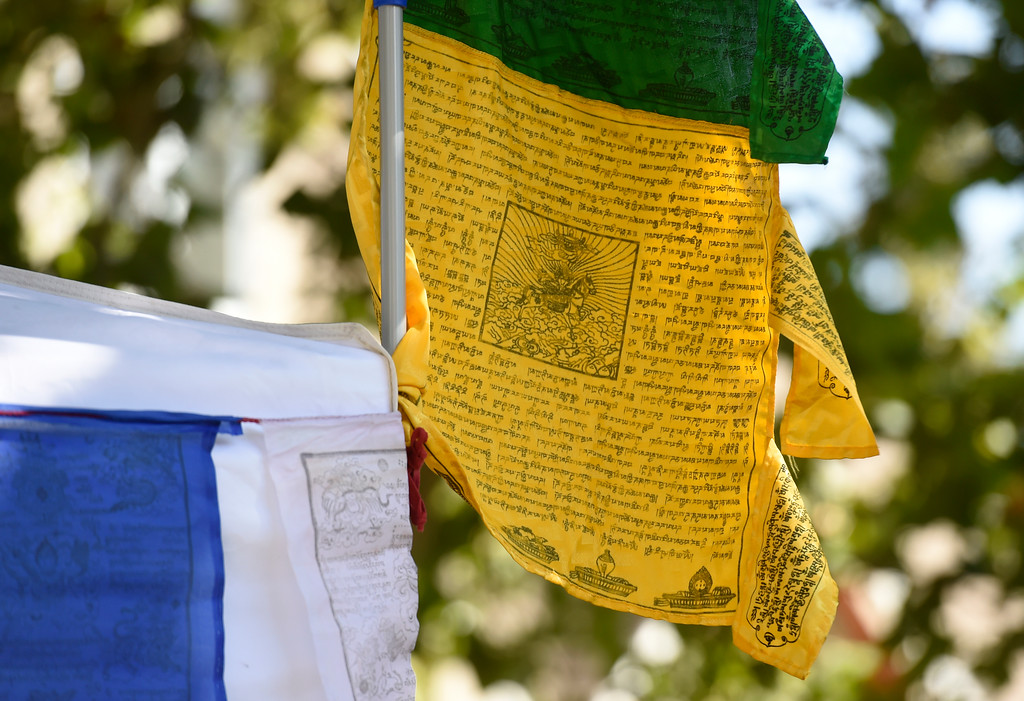 . Prayer flags blow in the wind as Buddhist monks from the Gaden Shartse Monastic Community in Mungod, India perform a sacred blessing ceremony at Naropa University on Tuesday in Boulder. The monks are visiting to create a Sacred Vajrasattva Sand Mandala at the Boulder Public Library for Jaipur Literature Festival. For more photos and video of the blessing go to dailycamera.com Jeremy Papasso/ Staff Photographer/ Sept. 12, 2017