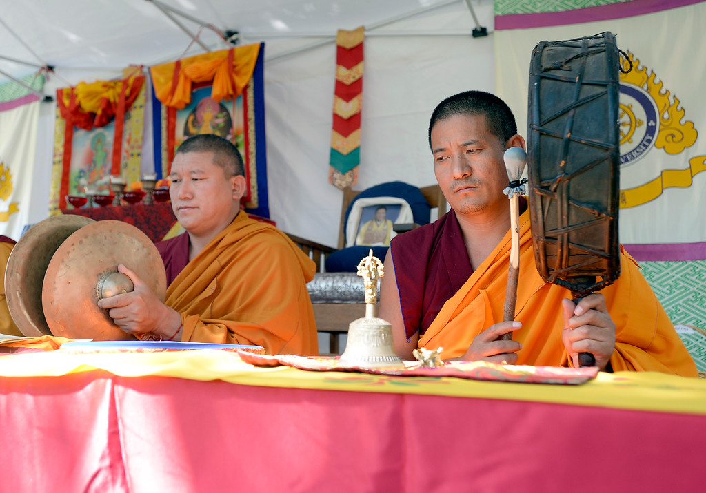 . Buddhist monks from the Gaden Shartse Monastic Community in Mungod, India perform a sacred blessing ceremony at Naropa University on Tuesday in Boulder. The monks are visiting to create a Sacred Vajrasattva Sand Mandala at the Boulder Public Library for Jaipur Literature Festival. For more photos and video of the blessing go to dailycamera.com Jeremy Papasso/ Staff Photographer/ Sept. 12, 2017