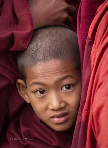 Novice Squashed Between Older Monks