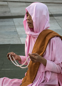 Nun Praying at Shwedagon