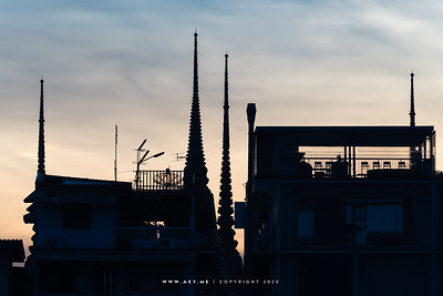 Silhouette of Wat Pho and buildings along the Chao Phraya River