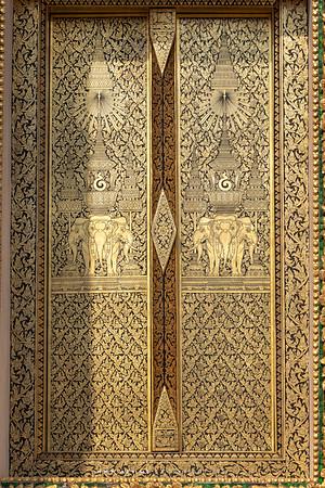 A Gold Leaf and Black Lacquered Window, the Insignia of King Rama IV, Unalom and the Erawan Elephant, Phra Ubosot, Wat Makut Kasatriyaram