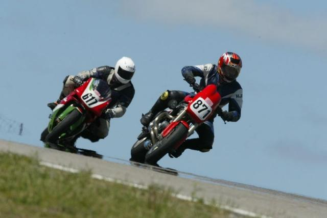 Top of Mosport's turn 2 sneeking under two Italian Superbikes. There's a guy on an Aprilia Mille