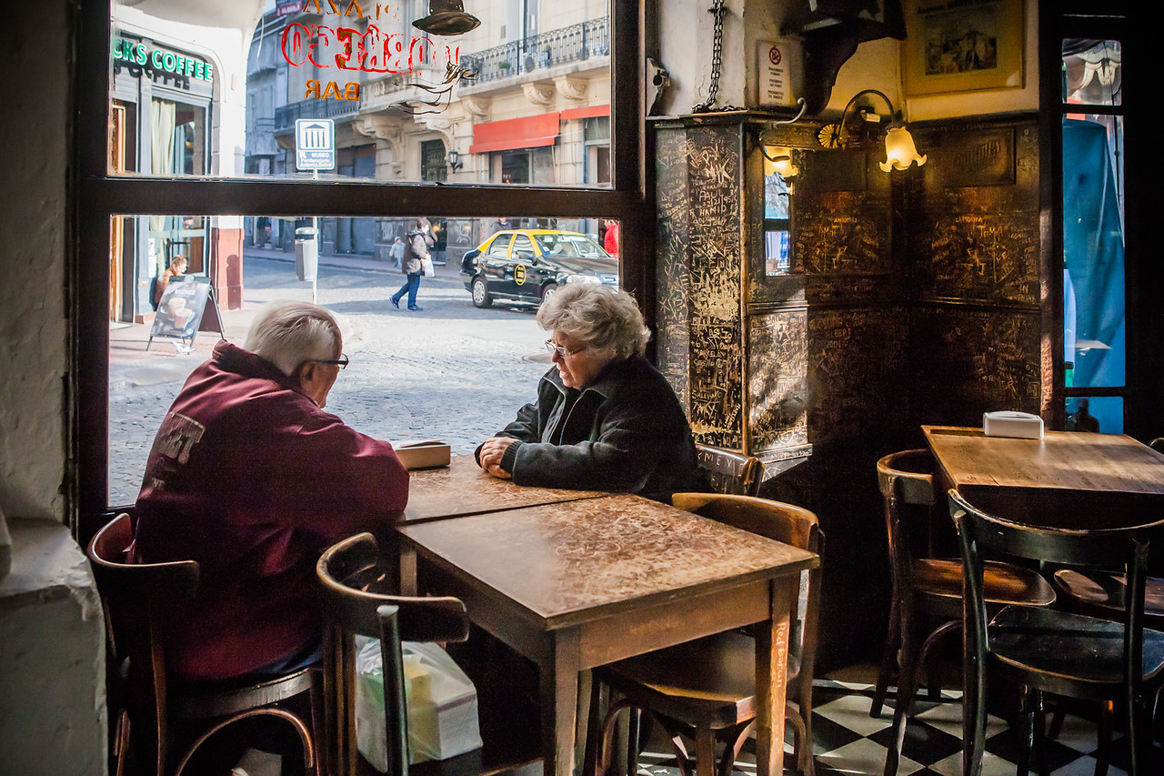 An old couple at Bar Plaza Dorrego in San Telmo, the oldest neighbourhood of Buenos Aires, Argentina