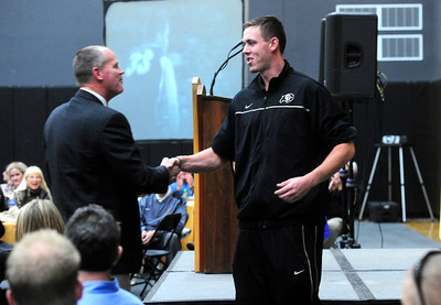 CUSIGNING Shane Harris-Tunks, a player with the University of Colorado's basketball team, introduces head coach Tad Boyle at a press conference announcing the new recruits for the men's and women's basketball teams and the volleyball team. For more photos, see www.dailycamera.com.  Photo by Marty Caivano/Nov. 9, 2011