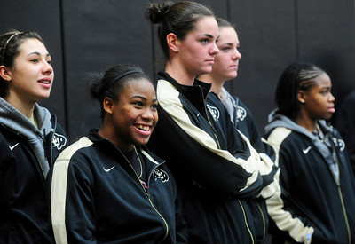CUSIGNING Members of the University of Colorado's women's basketball team, from left, Jasmine Sborov, Brittany Wilson, Megan Malcolm-Peck, Brenna Malcolm-Peck and Ashley Wilson watch videos of new players at a press conference announcing the new recruits for the men's and women's basketball teams and the volleyball team. For more photos, see www.dailycamera.com. Photo by Marty Caivano/Nov. 9, 2011