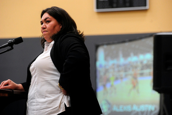"""CUSIGNING<br /> Liz Kritza, the head coach for the University of Colorado volleyball team, watches while videos of new players are shown at a press conference announcing the new recruits for the men's and women's basketball teams and the volleyball team. For more photos, see  <a href=""""http://www.dailycamera.com"""">http://www.dailycamera.com</a>.<br /> <br /> Photo by Marty Caivano/Nov. 9, 2011"""