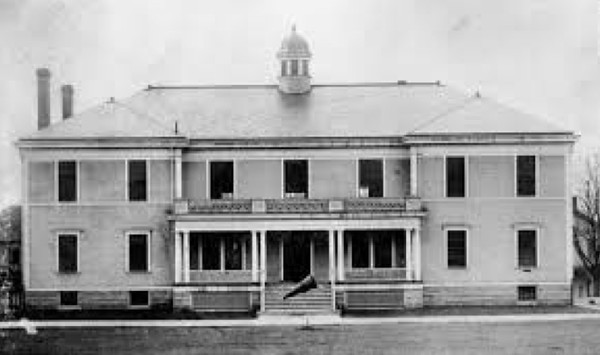 The headquarters building in the early 1900s. The conical item in front of the entry is a large megaphone used to amplify officers' commands as they drilled troops on the Parade Grounds.