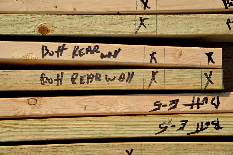 Pre-cut and marked 2x4s waiting to be put to use at the Build-A-Block Habitat for Humanity project in South Raleigh.