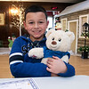 The Leominster Rotarey Club held a poster contest for third graders in the city. They where to create a poster the best depicted how the rotary makes the city better. The students submitted their ideas and and two winner was picked by the rotary. Then 100 of the students that made poster were picked to come to city hall on Saturday and participate in Make a Bear program. The winner of the contest got a $100 gift card. Hugging his finished bear is Gabriel Vargas, 8. SENTINEL & ENTERPRISE/JOHN LOVE