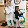 The Leominster Rotarey Club held a poster contest for third graders in the city. They where to create a poster the best depicted how the rotary makes the city better. The students submitted their ideas and and two winner was picked by the rotary. Then 100 of the students that made poster were picked to come to city hall on Saturday and participate in Make a Bear program. The winner of the contest got a $100 gift card. Showing off their finished bears are Maya Fouche, 9, and Makai Mallory, 2, in front of the rotary clubs poster. SENTINEL & ENTERPRISE/JOHN LOVE