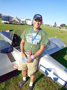 Dennis Broooks - Standing by his UltraCruiser (Oshkosh 2015)