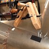 Old style wooden clamps help fit the Dorsal Fin in place