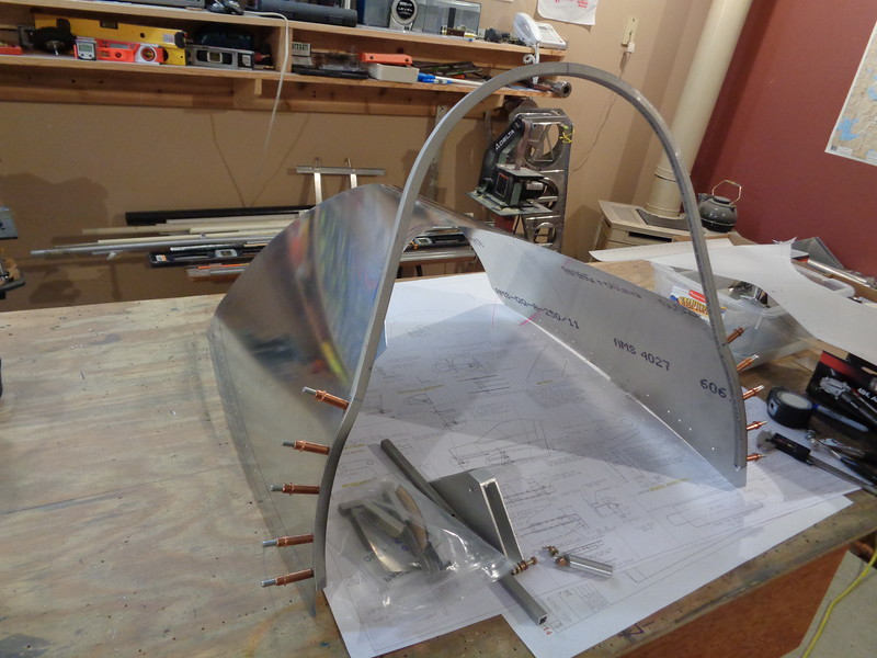 Instrument Cover and Canopy Bow removed from aircraft after back drilling.