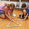 Kids got out of the heat on Tuesday an became engineers for the day at the Stevens Memorial Library in Ashburnham. Engineers design all kinds of things including bridges that are safe and secure. The kids used newspaper, tape, and other materials to design and build a bridge together. They tested it for strength, get feedback, and tried to improve their design. Kaley Morse, 10, and Jonas Wiita, 10, work together on one of the sides of the bridge. SENTINEL & ENTERPRISE/JOHN LOVE