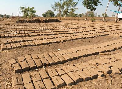 The villagers manufacture bricks to line the well.