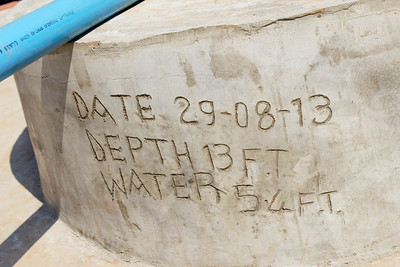 The well is marked with its date of completion, depth, and water level.