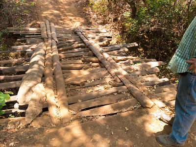 Roads in the back country are primitive or non-existent with bridges providing some of the most exciting challenges (yes, we did make it across this one safely!).