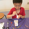 Kids put together some cars during a program at the Leominster Public Library on July 17, 2019. Ethan Lao, 7, of Sterling works on putting his car together at the program. SENTINEL & ENTERPRISE/JOHN LOVE