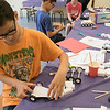 Kids put together some cars during a program at the Leominster Public Library on July 17, 2019. Nico Vicioso, 11, of Leominster works on putting his car together at the program. SENTINEL & ENTERPRISE/JOHN LOVE