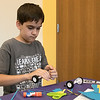 Kids put together some cars during a program at the Leominster Public Library on July 17, 2019. Luca Puglisi, 11, of Leominster works on putting his cars wheels together at the program. SENTINEL & ENTERPRISE/JOHN LOVE