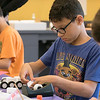 Kids put together some cars during a program at the Leominster Public Library on July 17, 2019. Johnny Vicioso, 11, of Leominster works on putting his car together at the program. SENTINEL & ENTERPRISE/JOHN LOVE