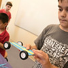Kids put together some cars during a program at the Leominster Public Library on July 17, 2019. Luca Puglisi, 11, from Leominster looks over the car he built during the program. SENTINEL & ENTERPRISE/JOHN LOVE