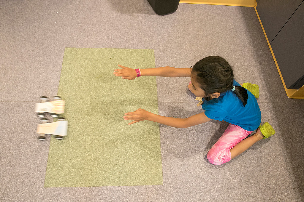 . Kids put together some cars during a program at the Leominster Public Library on July 17, 2019. Amaya Woods, 8, of Fitchburg tests the two cars she built during the program. SENTINEL & ENTERPRISE/JOHN LOVE