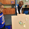 Lunenburg Public Library's Saturday STEM program created an engineering challenge too try and build a dog sled that they raced down a ramp to see how well it was built. The idea was to build it with popsicles sticks, tape, straws, scissors and pipe cleaners. They were to build it so that it could hold small pom poms. Julian Plaza, 4, watches as Childrens LibrarianDebbie Laffond starts a race between his sled and two others during the program. SENTINEL & ENTERPRISE/JOHN LOVE