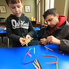 Lunenburg Public Library's Saturday STEM program created an engineering challenge too try and build a dog sled that they raced down a ramp to see how well it was built. The idea was to build it with popsicles sticks, tape, straws, scissors and pipe cleaners. They were to build it so that it could hold small pom poms. Leonidas Ciampa, 5, and his dad Marcello Ciampa work together to build a sled during the STEM program. SENTINEL & ENTERPRISE/JOHN LOVE