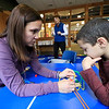 Lunenburg Public Library's Saturday STEM program created an engineering challenge too try and build a dog sled that they raced down a ramp to see how well it was built. The idea was to build it with popsicles sticks, tape, straws, scissors and pipe cleaners. They were to build it so that it could hold small pom poms. Adrianez Gonzalez and her son Jeriel Plaza, 8, work together to build a sled during the STEM program. SENTINEL & ENTERPRISE/JOHN LOVE