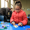 Lunenburg Public Library's Saturday STEM program created an engineering challenge too try and build a dog sled that they raced down a ramp to see how well it was built. The idea was to build it with popsicles sticks, tape, straws, scissors and pipe cleaners. They were to build it so that it could hold small pom poms. Naomi Cespedes, 9, works on her sled during the program. SENTINEL & ENTERPRISE/JOHN LOVE