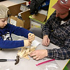 Garrett Davis, 6, and his dad Steve Davis of Ashburnham work on building and painting a wooded plane at a program put on by Robert Leduc of Wooden Toys and Crafts at the Stevens Memorial Library in Ashburnham. SENTINEL & ENTERPRISE/JOHN LOVE