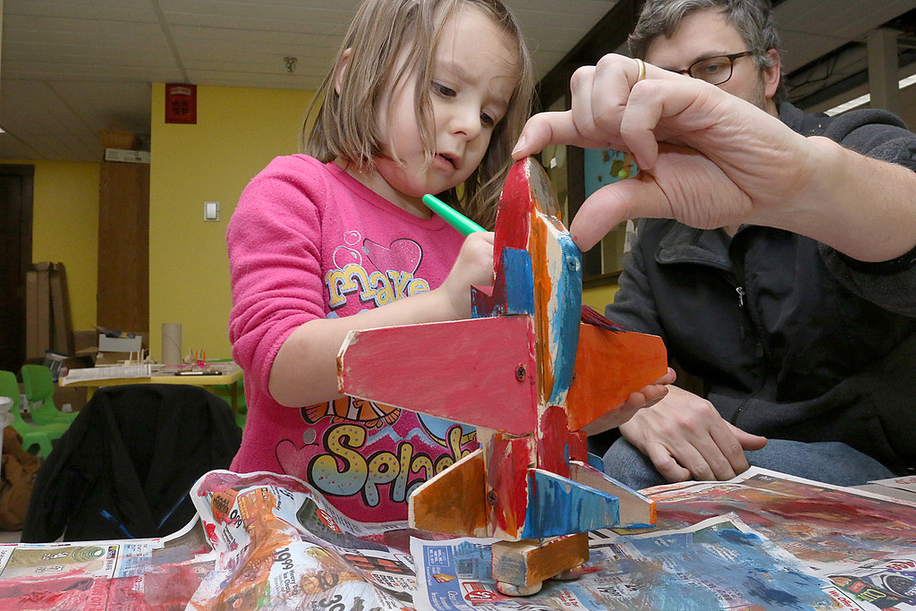 . Hazel Morrison, 3, and her dad lazarus Morrison of Ashburnham works on building and painting at a program with instructor Robert Leduc of Wooden Toys and Crafts at the Stevens Memorial Library in Ashburnham. SENTINEL & ENTERPRISE/JOHN LOVE